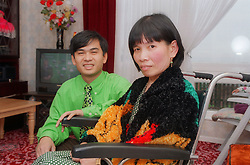 Woman; who is wheelchair user; at home with partner,