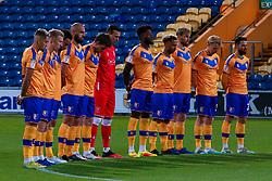 Mansfield Town players during a minute silence - Mandatory by-line: Ryan Crockett/JMP - 27/10/2020 - FOOTBALL - One Call Stadium - Mansfield, England - Mansfield Town v Barrow - Sky Bet League Two