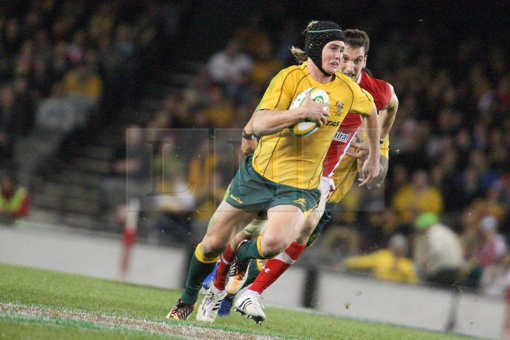 © Licensed to London News Pictures. 16/06/2012. Etihad Stadium, Melbourne Australia. Berrick Barnes runs with the ball towards the try line during the 2nd Rugby Test between Australia Wallabies Vs Wales . Photo credit : Asanka Brendon Ratnayake/LNP