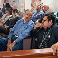 Navajo Nation Council Delegate Seth Damon speaks with his grandfather Charles Damon II while he waits for results of the vote for speaker, Monday, Jan 28 at the council chamber in Window Rock, Ariz.