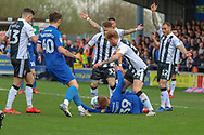 AFC Wimbledon striker Joe Pigott (39) battles for possession whilst laying on the floor during the EFL Sky Bet League 1 match between AFC Wimbledon and Gillingham at the Cherry Red Records Stadium, Kingston, England on 23 March 2019.