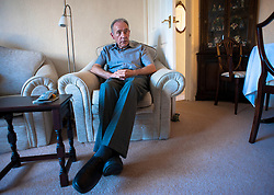 © Licensed to London News Pictures. 09/04/2014<br /> <br /> Durham, United Kingdom<br /> <br /> Parkinson's Disease sufferer David Forsyth from Brandon, County Durham sits in his armchair at the bungalow he shares with his wife Judy as he waits for her to bring him his medication.<br /> <br /> Parkinson's is a long-term neurological condition that affects the way the brain co-ordinates body movements including walking, talking and writing and affects both men and women.<br /> <br /> Photo credit : Ian Forsyth/LNP