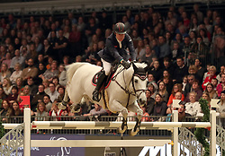 Britain's Michael Whitaker riding Valmy de la Lande competes in the Christmas Masters during day five of the London International Horse Show at London Olympia.