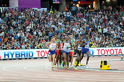 London, August 12 2017 . Mo Farah, Great Britain, and Paul Kipkemoi Chelimo, USA, lead the pack in the men's 5000m final on day nine of the IAAF London 2017 world Championships at the London Stadium. © Paul Davey.