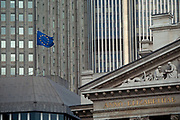 The EU flag flies over 1990s financial institutions of the City of London aka The Square Mile in the capitals financial centre, on 16th June 1994, in London, England.