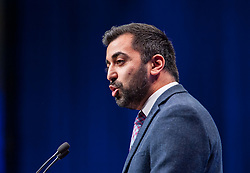 Pictured: Justice Secretary Humza Yousaf delivers his speech at the first day of the SNP autumn conference at the SEC in glasgow.<br /> <br /> © Dave Johnston / EEm