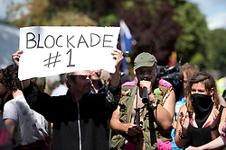 © London News Pictures. 19/08/2013. Balcombe, UK. Activists confront police outside to the Cuadrilla drilling site in Balcombe, West Sussex on a day of of civil disobedience organised by campaign group No Dash For Gas. Cuadrilla has temporarily ceased drilling at the site, which has been earmarked for fracking, under advice from the police. Photo credit: Ben Cawthra/LNP