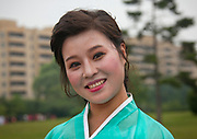 Fashion in North Korea<br /> <br /> In every corner of the earth, women love to look beautiful and keep up with the latest fashion trends. The women of North Korea are no different. Fashion is taken seriously here. But in North Korea, women do not read Elle or Vogue; they just glimpse a few styles by watching TV or by observing the few foreigners who come to visit. In the hermit kingdom, clothing also reflects social status. If you have foreign clothes it means you travel and are consequently close to the centralized power. Chinese products have inundated the country, adding some color to the traditional outfits that were made of vynalon fiber. But citizens beware, too much style means you're forgetting the North Korean juche, the ethos of self-reliance that the country is founded on! But the youth tend to neglect it despite the potential consequences.<br /> <br /> Photo shows: <br /> Clash of civilization... Kil Il Sung Vs Prada...<br /> The clothing floor in one of the biggest malls in Pyongyang. This kind of store is reserved for the elite, but still the selection remains very limited. Many North Korean students can watch movies from the west when they study English, but they all told me it was impossible to find the clothes from the films in their country. I found some Adidas shoes in this store, at the high price of 100 US dollars.<br /> In a shop of a luxury hotel in Pyongyang, high end perfumes can be bought with euros. Most of these products however are made in China.<br /> Every north korean woman will tell you she dreams to buy a perfume from Paris... They'll have to wait a little bit...<br /> Very white skin is seen as an attractive trait in North Korea. Darker skin signifies that you work in the fields and are part of a lower cast. Girls use rice powder to make themselves more pale.<br /> Pale must be maintained, in any situation!<br /> Using UV tanning beds to look like you were out in the sun is not yet a trend in North Korea. They only use them for women who have just given birth in the Pyongyang hospital. It is