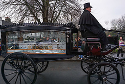 © Licensed to London News Pictures. 9/12/2020 Hull, UK. Horse-drawn hearses carrying the coffin of 11-year-old Mason Deakin as his funeral cortège passes through the streets of Hull. Mason Deakin, 11, and his best friend Steven Duffield, 10, died after the bike they were riding was hit by a car on Anlaby Road in Hull, East Yorkshire, on Monday, October 19. Photo credit: Ioannis Alexopoulos/LNP