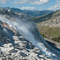 Hot water pours down terraced mineral deposits at Mammoth Hot Springs, Yellowtone National Park, Wyoming