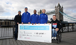 Winner of the men's 2018 Virgin Money London Marathon wheelchair race Great Britain's David Weir with a cheque for the Weir Archer Academy during a photocall outside Tower Bridge, London.