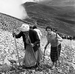 The arduous climbed up to the top of Croagh Patrick at Westport, Co. Mayo, for pilgrims. It has been the place of pilgrimage since St Patrick's time, and some said before that, on 'Reek Sunday', which was the last Sunday in July, thousands of people made the treacherous ascent to the top.<br /> <br /> 29th July 1962