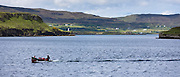 Tourists on sealwatching boat trip on loch at Dunvegan Castle, the Highlands ancestral home of the MacLeod clan, the Isle of Skye, Scotland