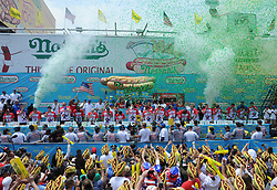 Competitors take part in the Nathan's Hot Dog Eating Contest at Coney Island of New York City, NY, USA, on July 4, 2018. Joey Chestnut set a new world record Wednesday by devouring 74 hot dogs in 10 minutes at the Nathan's Hot Dog Eating Contest in New York. Miki Sudo defended the women's title by eating 37 hot dogs in 10 minutes. Photo by Dennis Van Tine/ABACAPRESS.COM