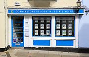 Cornerstone estate agent shop window Market Hill, Woodbridge, Suffolk, England, UK