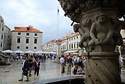 Small Onofrio Fountain, built in 1438, with tourists in background. Dubrovnik old town, Croatia