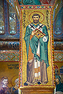 Medieval Byzantine style mosaics of St Augusten,  the Palatine Chapel, Cappella Palatina, Palermo, Italy .<br /> <br /> If you prefer you can also buy from our ALAMY PHOTO LIBRARY  Collection visit : https://www.alamy.com/portfolio/paul-williams-funkystock/byzantine-art-antiquities.html . Type -    Palatine     - into the LOWER SEARCH WITHIN GALLERY box. Refine search by adding background colour, place, museum etc<br /> <br /> Visit our BYZANTINE MOSAIC PHOTO COLLECTION for more   photos  to download or buy as prints https://funkystock.photoshelter.com/gallery-collection/Roman-Byzantine-Art-Artefacts-Antiquities-Historic-Sites-Pictures-Images-of/C0000lW_87AclrOk