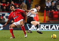 Photo. Daniel Hambury.<br /> Barclays Premiership.<br /> Charlton Athletic v Fulham. 20/12/2004.<br /> Charlton's Jonathan Fortune catches Fulham's Brian McBride