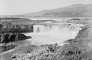9305-B7379. View of Celilo Falls before 1932. Note lack of construction on Albert Brothers island. Photographed early in the season, the building of platforms has just begun. Water is still high from the spring freshet.