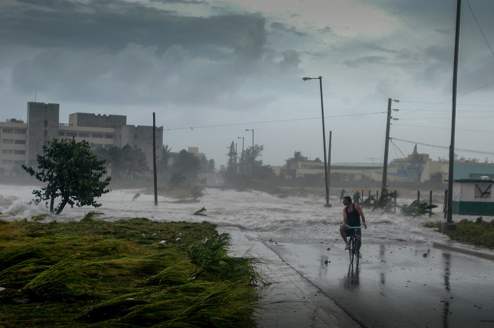 Sea water floods over a road in Havana, Cuba during a storm. Increasing extreme weather events in Cuba and the region are linked to climate change.