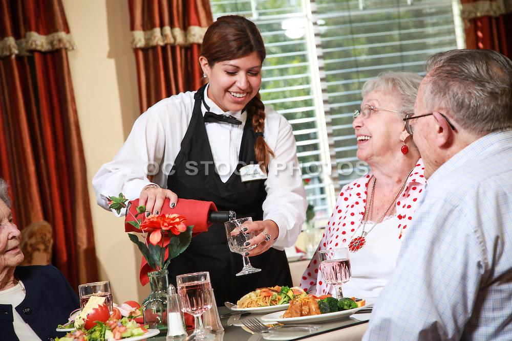 Waitress Pouring Wine at Senior Living