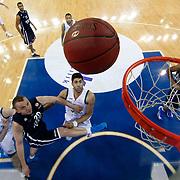 Anadolu Efes's Dusko Savanovic (3ndL) during their Euroleague Top 16 game13 basketball match Anadolu Efes between Unicaja Malaga at the Abdi Ipekci Arena in Istanbul at Turkey on Thursday, March, 28, 2013. Photo by Aykut AKICI/TURKPIX