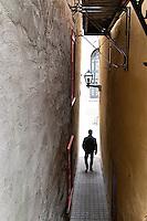 Richard walks through a narrow passageway in old Quebec City.