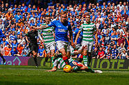 Scott Arfield of Rangers FC gets on the end of a through ball and heads towards goal during the Ladbrokes Scottish Premiership match between Rangers and Celtic at Ibrox, Glasgow, Scotland on 12 May 2019.