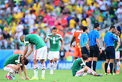 29.06.2014, Castelao, Fortaleza, BRA, FIFA WM, Niederlande vs Mexico, Achtelfinale, im Bild enttäuschte Mexikanische Teamspieler nach ihrer 2:1 Niederlage gegen Mexico // during last sixteen match between Netherlands and Mexico of the FIFA Worldcup Brazil 2014 at the Castelao in Fortaleza, Brazil on 2014/06/29. EXPA Pictures © 2014, PhotoCredit: EXPA/ fotogloria/ Best Photo Agency<br /> <br /> *****ATTENTION - for AUT, FRA, POL, SLO, CRO, SRB, BIH, MAZ only*****