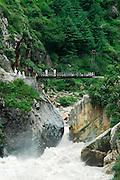 India, Kasol, Kullu District, Himachal Pradesh, Northern India A bridge over a river of gushing water