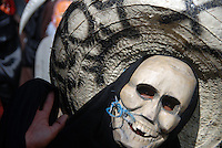 """MEXICO, Veracruz, Tantoyuca, Oct 27- Nov 4, 2009. Traditional wooden mask firmly in place, a """"xantolo"""" dancer practices in Tantoyuca's """"Plaza Constitucion."""" """"Xantolo,"""" the Nahuatl word for """"Santos,"""" or holy, marks a week-long period during which the whole Huasteca region of northern Veracruz state prepares for """"Dia de los Muertos,"""" the Day of the Dead. For children on the nights of October 31st and adults on November 1st, there is costumed dancing in the streets, and a carnival atmosphere, while Mexican families also honor the yearly return of the souls of their relatives at home and in the graveyards, with flower-bedecked altars and the foods their loved ones preferred in life. Photographs for HOY by Jay Dunn."""