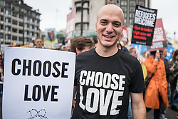 © Licensed to London News Pictures. 17/09/2016. London, UK. Refugee Hassan Akkad, who appeared in the TV series Exodus, joins thousands to march through central London to call on the government to welcome refugees to the UK. Photo credit: Rob Pinney/LNP