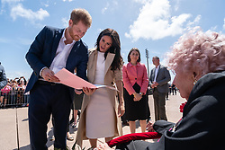AU_1372468 - Sydney, AUSTRALIA  -   Closeup shoots of Prince Harry and Meghan meeting Daphne Dunne at the Opera House<br /> <br /> Pictured: Prince Harry, Meghan Markle, Daphne Dunne<br /> <br /> BACKGRID Australia 16 OCTOBER 2018 <br /> <br /> BYLINE MUST READ: Michelle Haywood / BACKGRID<br /> <br /> Phone: + 61 2 8719 0598<br /> Email:  photos@backgrid.com.au