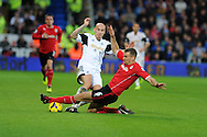 Swansea's Jonjo Shelvey (l) is tackled by Cardiff city's Ben Turner.  Barclays Premier League match, Cardiff city v Swansea city at the Cardiff city stadium in Cardiff, South Wales on Sunday 3rd Nov 2013. pic by Andrew Orchard, Andrew Orchard sports photography,