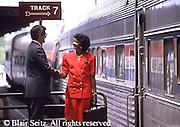 female, executives, managers, train platform