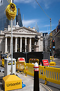 A coil of electrical wiring cables is above the heads of pedestriansnear Royal Exchange on Threadneedle Street - part of ongoing alterations to the highway during the Coronavirus pandemic in the City of London, the capitals financial district, on 30th July 2020, in London, England.  SRL are the UK's only manufacturer to sell and hire traffic light equipment and their Urban64 product is the first, and only, permanent technology system to be designed uniquely for temporary installations in the U.K. The Urban64 design allows for simple and quick over-head installation, with the ability to replicate the technology provided by the preceding permanent system, and therefore maintaining traffic flow efficiency.