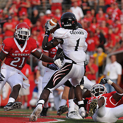Sep 7, 2009; Piscataway, NJ, USA; Cincinnati wide receiver Marshwan Gilyard (1) catches a touchdown during the first half of Rutgers 47-15 loss to Cincinnati in NCAA college football at Rutgers Stadium.
