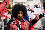 Hundreds of women demonstrate to demand the end of violence by men towards women at the Million Women Rise march on 7th March, 2020 in London, United Kingdom. Many of the protesters wear red clothing to symbolise the blood of women murdered and raped at the hands of male violence.