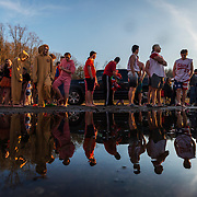 Participants are reflected in a pool of water as they wait their turn in line during the 2019 Polar Plunge at Hurricane City Park in Hurricane, W.V., on Saturday, February 02, 2019.