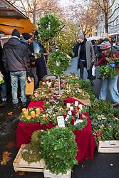 Christmas decorations and wreaths for sale at weekend market in Kollwitzplatz Prenzlauer Berg , Berlin, Germany