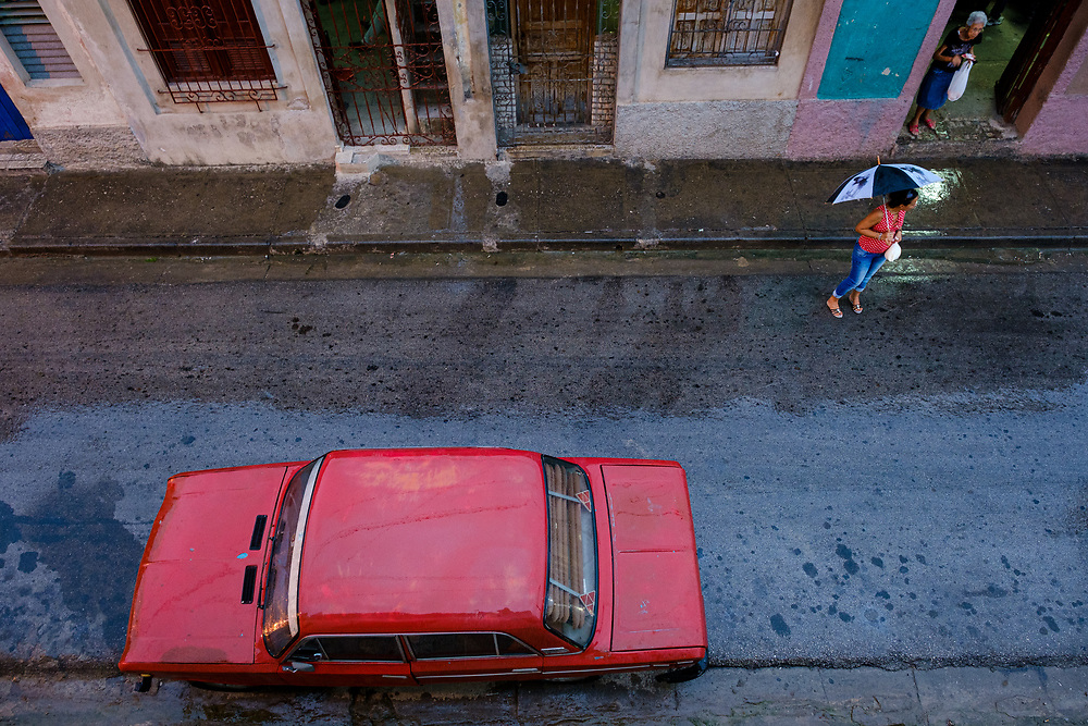SANTIAGO DE CUBA, CUBA - CIRCA JANUARY 2020: Typical street scene in Santiago de Cuba during a rainy day.