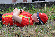 a Wales fan takes a knap in the sun outside the stadium before k/o. Euro 2016, Wales v Slovakia at Matmut Atlantique , Nouveau Stade de Bordeaux  in Bordeaux, France on Saturday 11th June 2016, pic by  Andrew Orchard, Andrew Orchard sports photography.