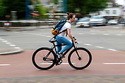 Een meisje fietst door Utrecht.<br /> <br /> A girl cycles at the city center of Utrecht.