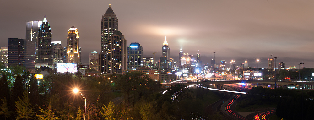 Downtown and Midtown Atlanta are seen on a cloudy night from the SCAD parking lot.