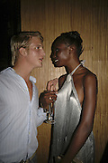 Giles Hugo and Sonja Wanda, Cartier Polo Players Party, The Collection, 264 Brompton Road, London, SW3, 25 July 2006. ONE TIME USE ONLY - DO NOT ARCHIVE  © Copyright Photograph by Dafydd Jones 66 Stockwell Park Rd. London SW9 0DA Tel 020 7733 0108 www.dafjones.com