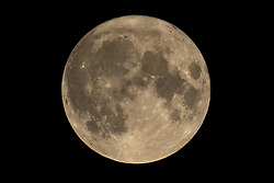 © Licensed to London News Pictures. 01/10/2020. Salford, UK. The 2020 Harvest Moon is seen over the sky of Greater Manchester . Also known as the Potato Harvest Moon, Worm Moon, Lenten Moon, Crow Moon, Sugar Moon, Chaste Moon, Sap Moon, it is the first of two full moons that will appear this month (October 2020) . Photo credit: Joel Goodman/LNP