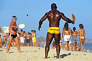 Men playing 'bat and ball' on Ipanema Beach. Rio de Janeiro.