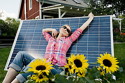 Solar panel young woman relaxing stretching