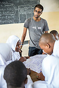ICS volunteer Bharat Thakrar in discussion about writing a CV and applying for work with students at Angaza school as part of the VSO / ICS Elimu Fursa project (Opportunities in Education) Lindi, Lindi region. Tanzania.