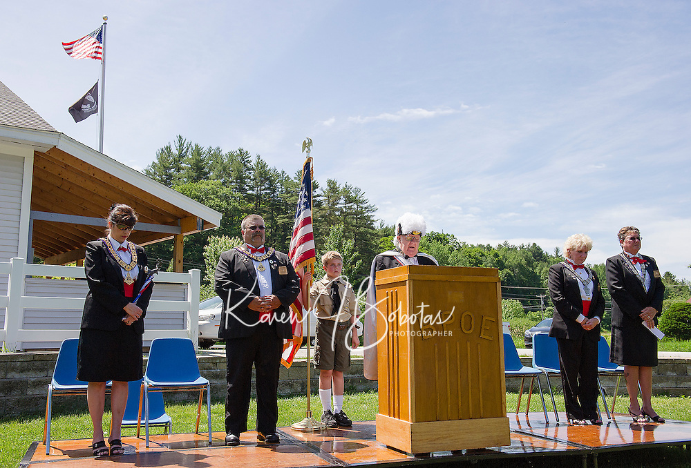 Knight of Columbus Chaplin Dick Guerin (center) gives a blessing during the Elks Lodge Flag Day ceremony on Sunday morning (l-r) Esquire Dotti Gath, Exalter Ruler Jim Cuplon, Adam Barton Boy Scout Troup 68, Leading Knight Jan Dignan and Lecturing Knight Margaret Mary Culpon.  (Karen Bobotas/for the Laconia Daily Sun)